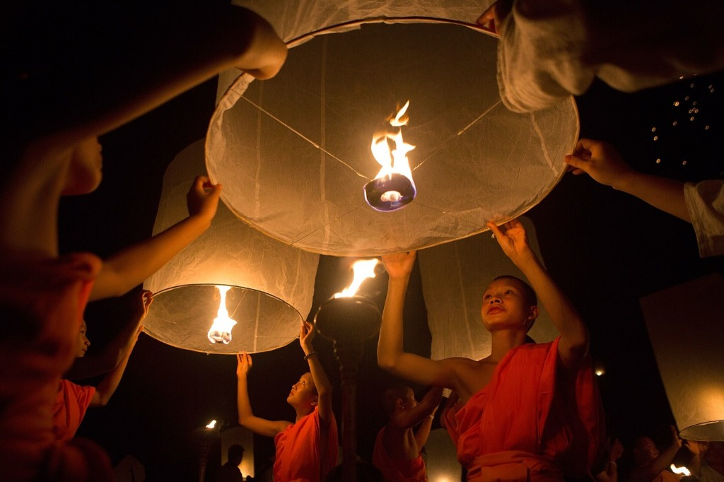 Thai monks prepare to release paper lanterns at the Lanna Dhutanka Temple in Chiang Mai, Thailand. Taylor Weidman/Getty Images