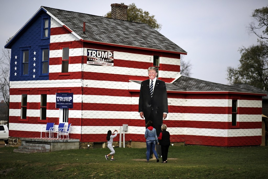 A giant photo of Donald Trump in front of the Trump House owned by Lisa Rossi in Youngstown, Pa. AP Photo/Gene J. Puskar