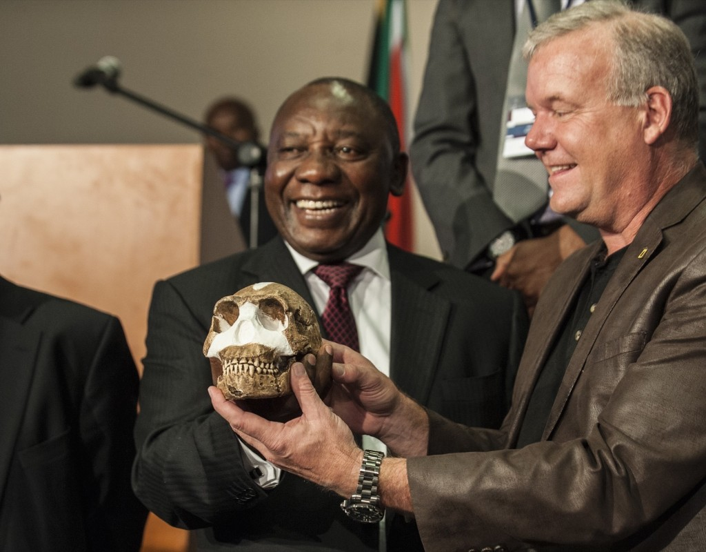 South African Deputy President Cyril Ramaphos and professor Lee Berger hold a replica of the skull of a Homo Naledi, a newly discovered human ancestor during the unveiling of the discovery, Thursday, in Maropeng. STEFAN HEUNIS/AFP/Getty Images