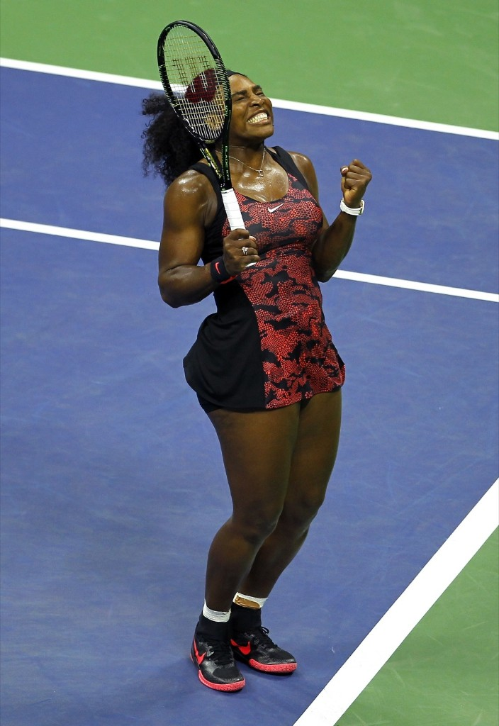 Serena Williams of the U.S. celebrates defeating her sister Venus Williams at the U.S. Open tennis tournament in New York, Tuesday. Gary Hershorn/Corbis