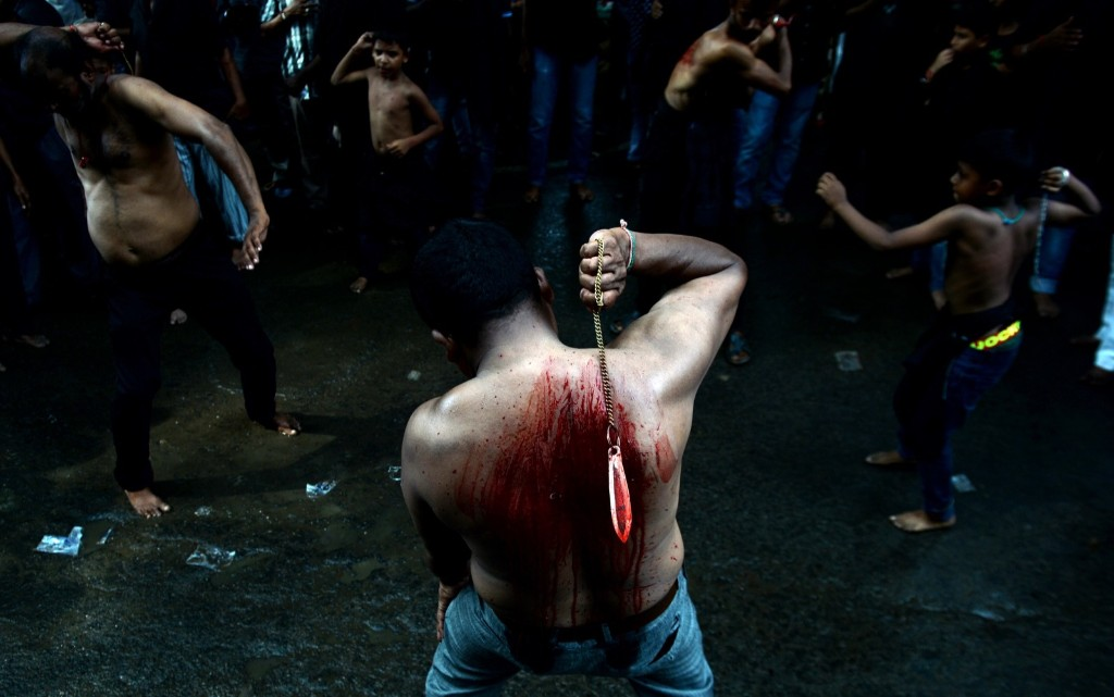 An Indian Shia Muslim flagellates himself during a religious procession on the sixth day of the mourning period of Muharram in Chennai. ARUN SANKAR/AFP/Getty Images