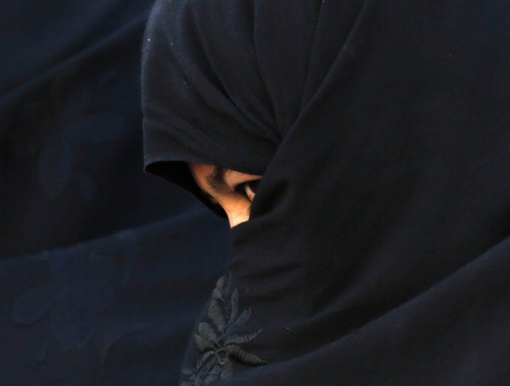 An Afghan woman attends a rally for presidential candidate Abdullah Abdullah in Chaghchran. REUTERS/Mohammad Ismail