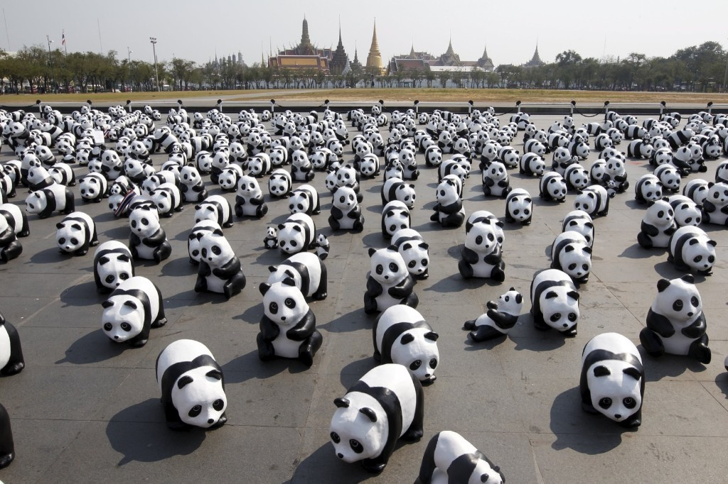 Panda sculptures in front of the Grand Palace during an exhibition by French artist Paulo Grangeon in Bangkok. REUTERS/Chaiwat Subprasom
