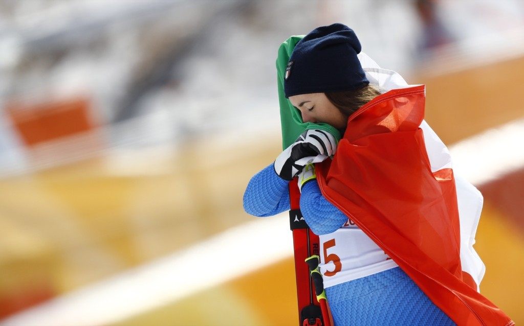 Sofia Goggia of Italy during the victory ceremony for women's downhill. REUTERS/Kai Pfaffenbach