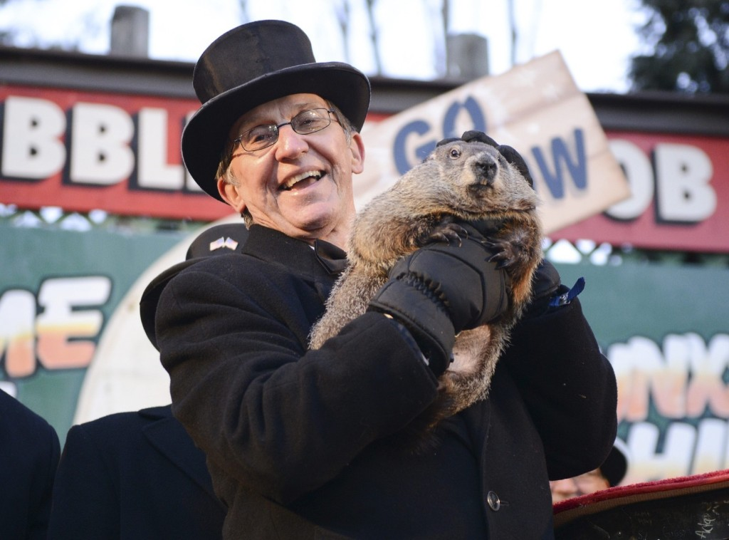 Groundhog co-handler Ron Ploucha holds up groundhog Punxsutawney Phil after Phil's annual weather prediction at Gobbler's Knob on the 130th Groundhog Day in Punxsutawney, Pa. The famed groundhog, with an even more famous shadow, emerged from his burrow on Tuesday and predicted an early spring. REUTERS/Alan Freed