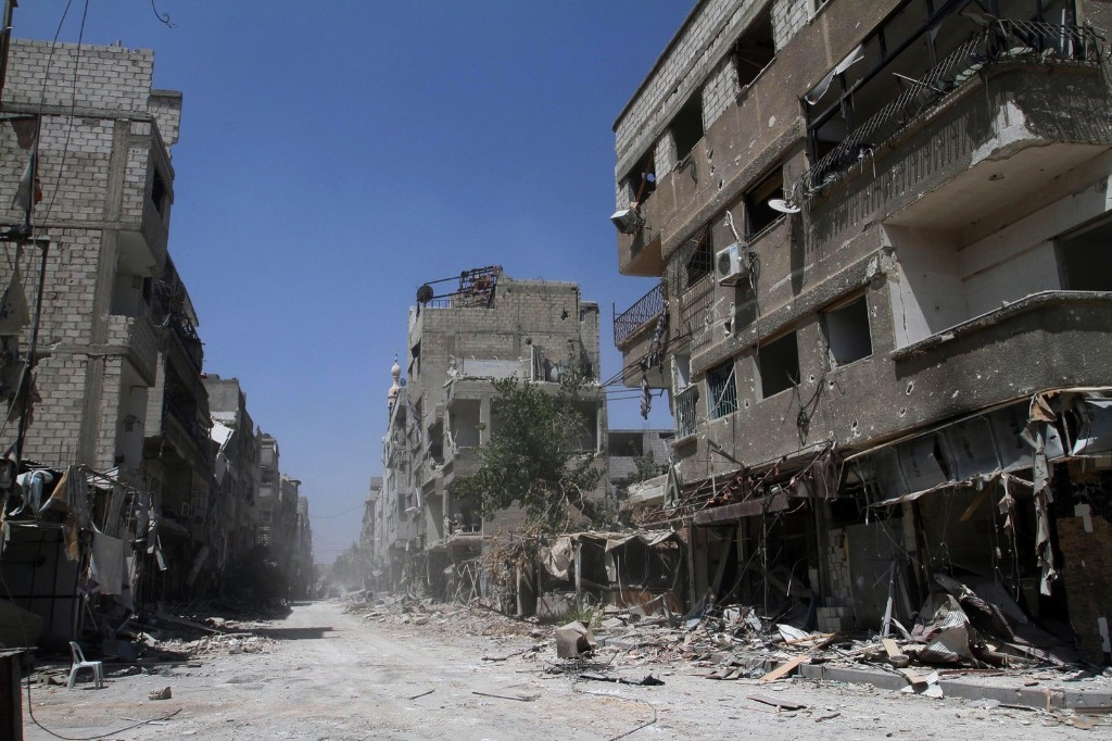 Buildings damaged during battles between Syrian troops and rebels on an empty street in Mleiha. AP Photo