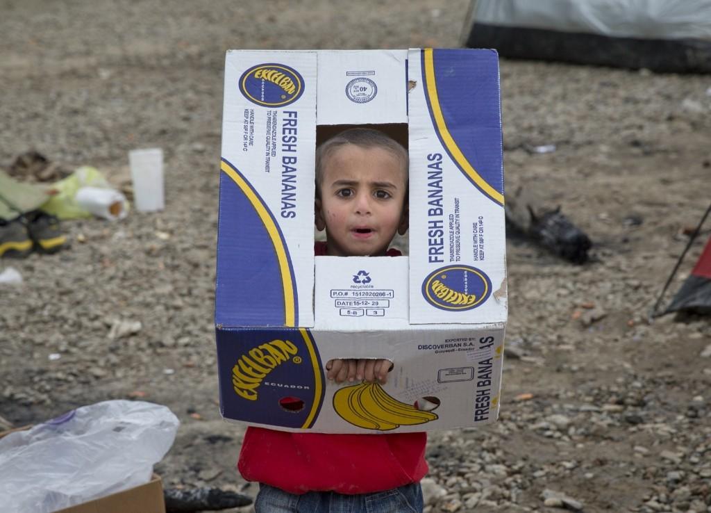 A migrant child at the northern Greek border station of Idomeni. AP Photo/Vadim Ghirda