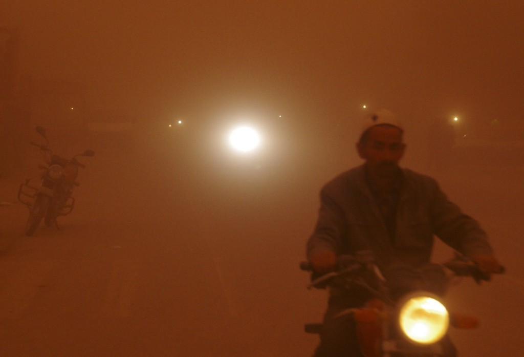 A man rides his motorcycle during a severe sandstorm in Aksu, Xinjiang Uighur Autonomous Region, China. REUTERS/Stringer