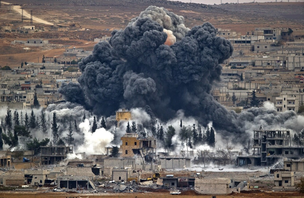 Smoke rises from Kobani following an airstrike by the US-led coalition. AP Photo/Vadim Ghirda