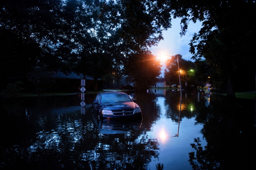 An abandoned car on a flooded street in Baton Rouge. BRENDAN SMIALOWSKI/AFP/Getty Images