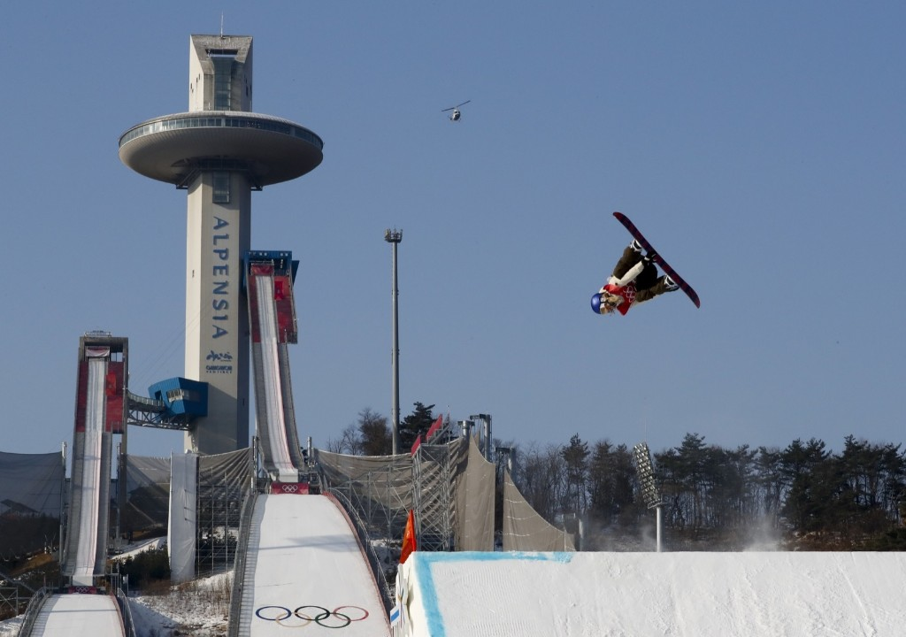 Anna Gasser of Austria taking gold in the women's big air final. AP Photo/Matthias Schrader