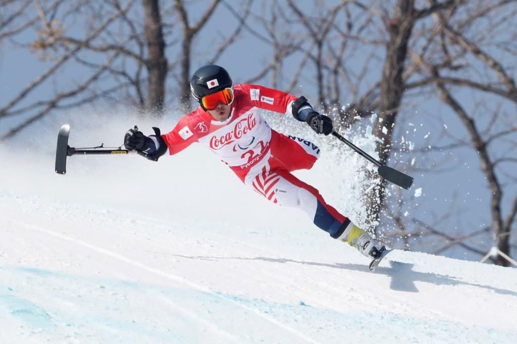 Hiraku Misawa of Japan competes in the men's standing downhill. REUTERS/Paul Hanna