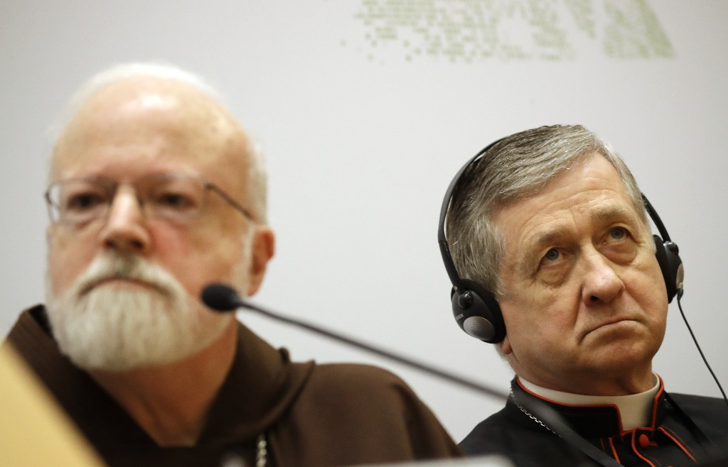 Chicago Archbishop Cardinal Blase J. Cupich, right, and Cardinal Sean Patrick O'Malley, listen to reporters' questions at a media briefing during a four-day sex abuse summit called by Pope Francis, in Rome, Friday, Feb. 22, 2019. Cardinals attending Pope Francis' summit on preventing clergy sex abuse called Friday for a new culture of accountability in the Catholic Church to punish bishops and religious superiors when they fail to protect their flocks from predator priests. (AP Photo/Alessandra Tarantino)