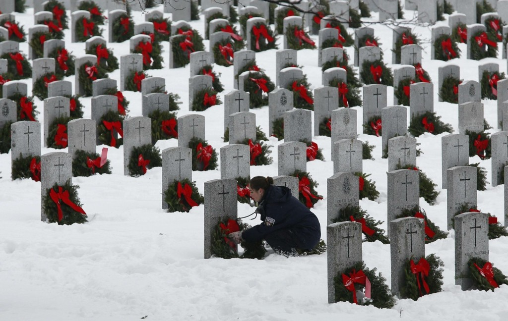 A woman during the Wreaths Across Canada ceremony at the National Military Cemetery in Ottawa, Sunday. REUTERS/Chris Wattie