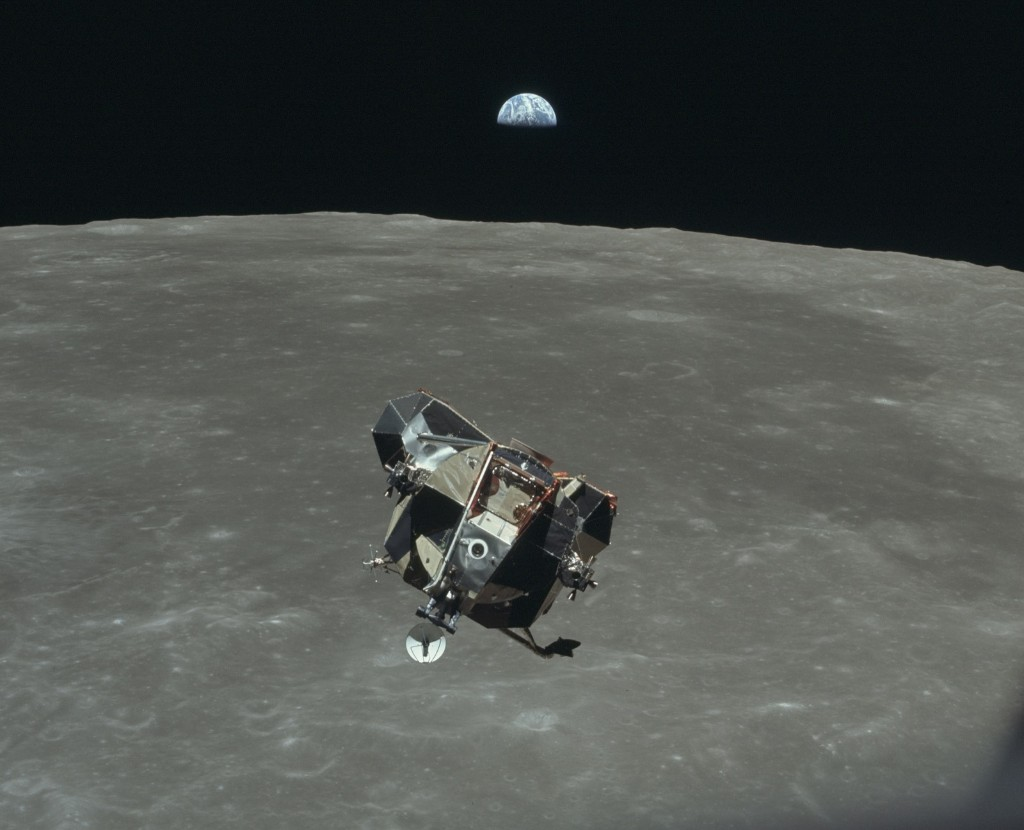 View of the earth, moon, and lunar module during ascent. Image was taken during the Apollo 11 mission. Original film magazine was labeled V. Film Type: S0-368 color taken with a 80mm lens. NASA Photo