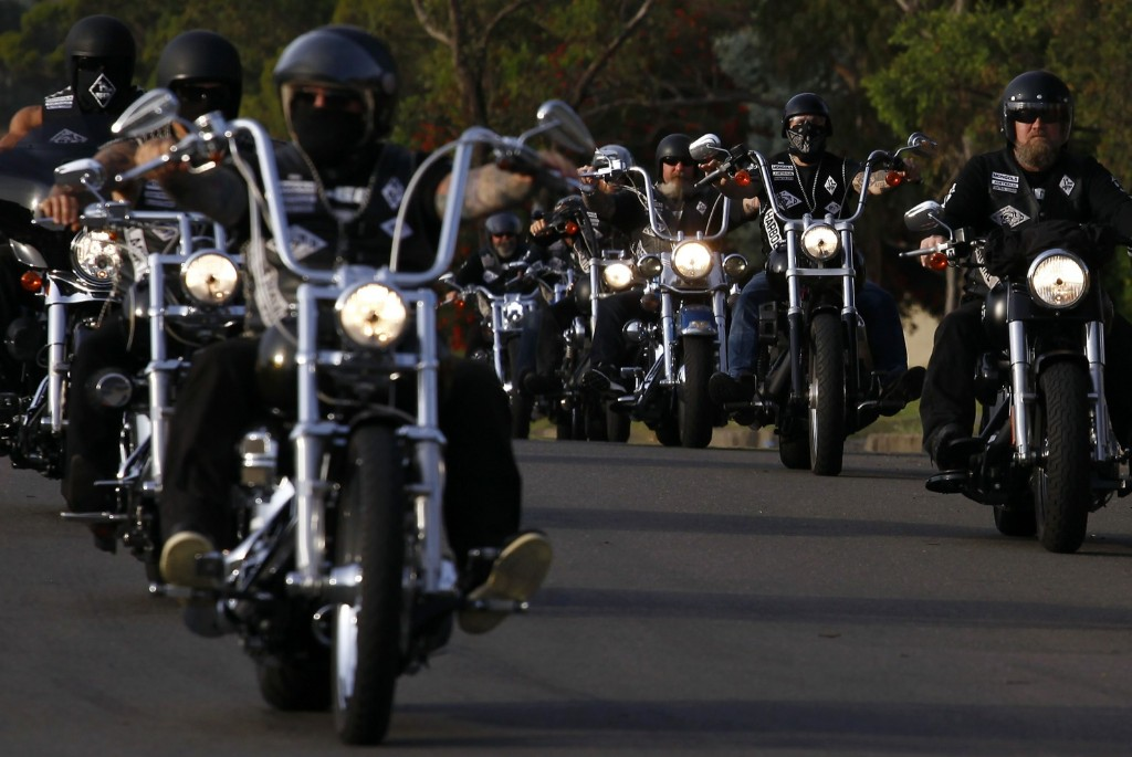 Members of the Mongols Motorcycle Club ride in formation in western Sydney. REUTERS/David Gray