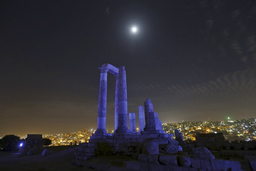 The moon over the Temple of Hercules during 70th anniversary celebration of the United Nations at the Citadel in Amman, Jordan. REUTERS/Muhammad Hamed