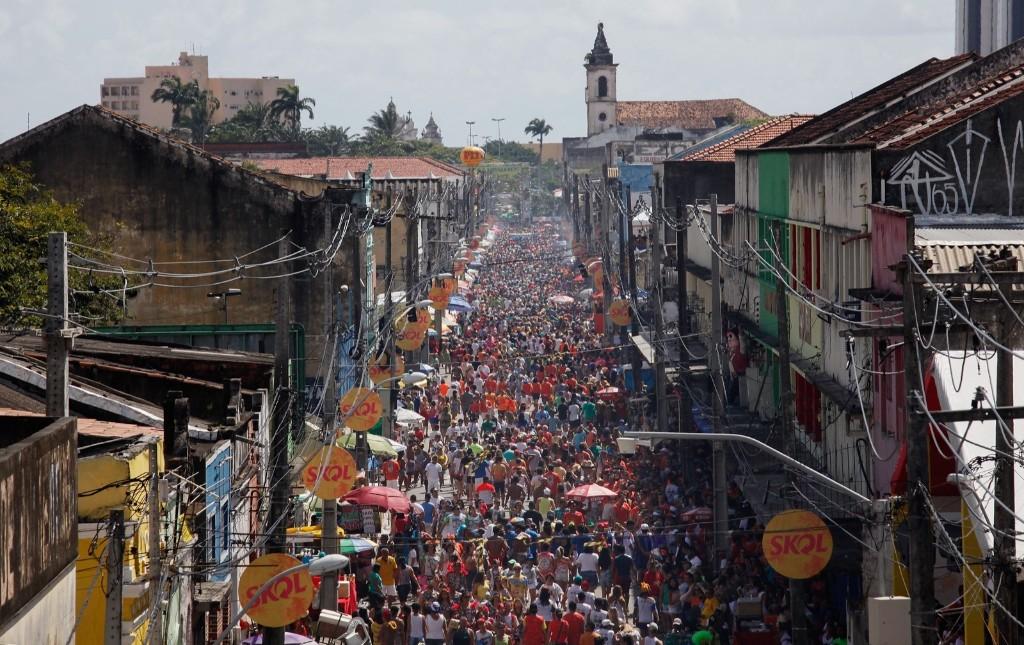 Revellers gather during the Galinho da Madrugada 'bloco', or street parade, in Recife. Mario Tama/Getty Images