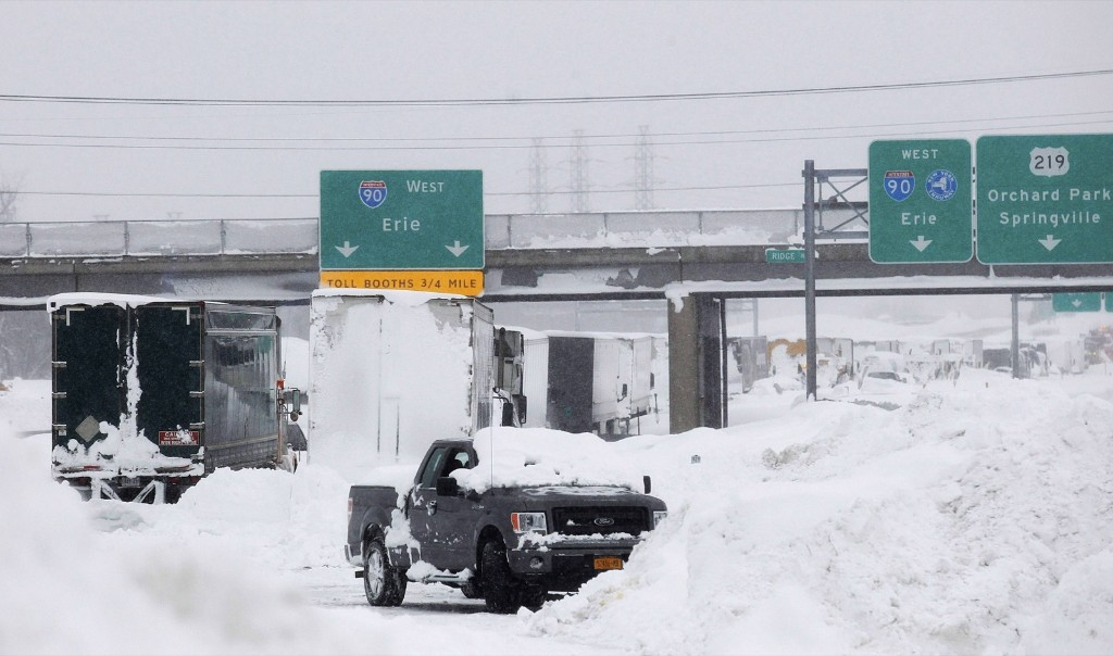 Vehicles litter the highway in West Seneca, New York, Wednesday. REUTERS/Sharon Cantillon/Buffalo News/Pool