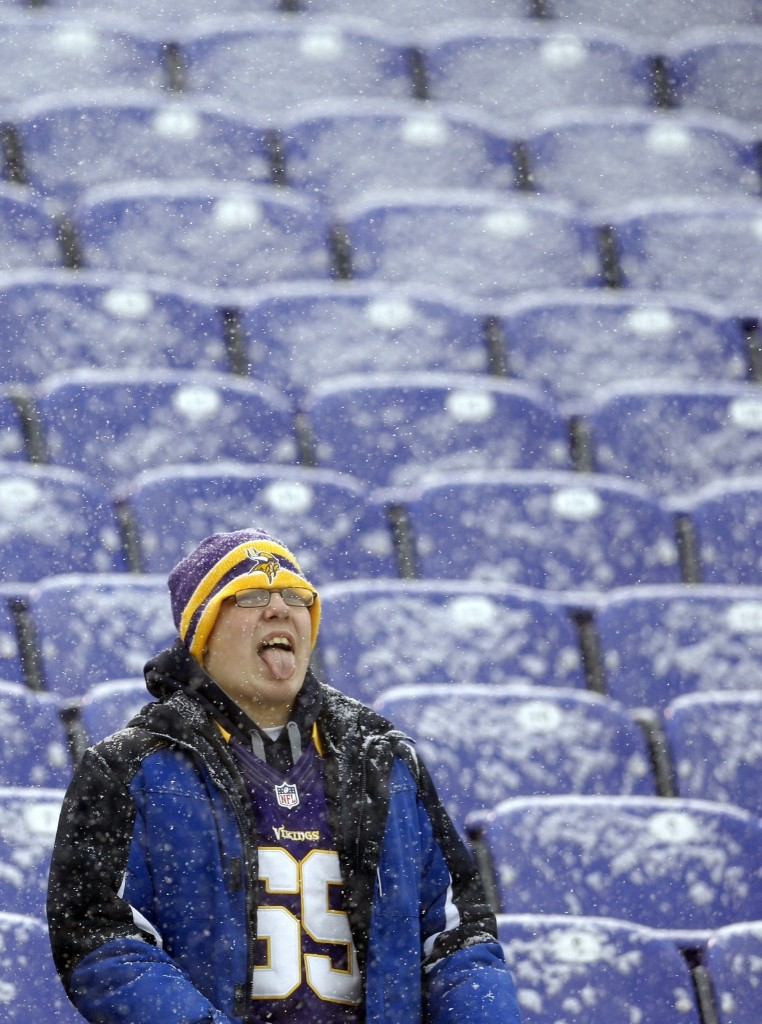 A Viking fan tries to catch snowflakes on his tongue in Baltimore. AP Photo/Patrick Semansky