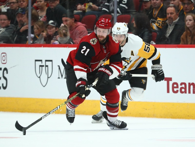 Jan 18, 2019; Glendale, AZ, USA; Arizona Coyotes center Derek Stepan (21) controls the puck against the Pittsburgh Penguins in the second period at Gila River Arena. Mandatory Credit: Mark J. Rebilas-USA TODAY Sports