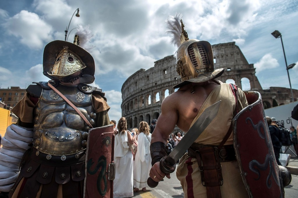Actors dressed as ancient Roman soldiers at the Coliseum as they attend a parade to commemorate the 2,768th anniversary of the founding of Rome. Giorgio Cosulich/Getty Images