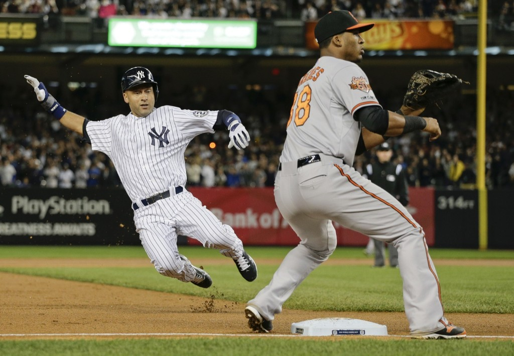 Derek Jeter takes third on a wild pitch in the first inning. AP Photo/Julie Jacobson