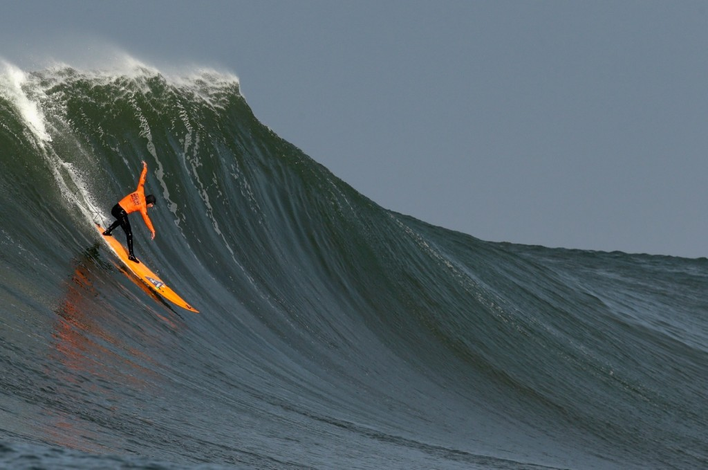 Tyler Fox rides a wave during round one of the Mavericks Invitational. Ezra Shaw/Getty Images