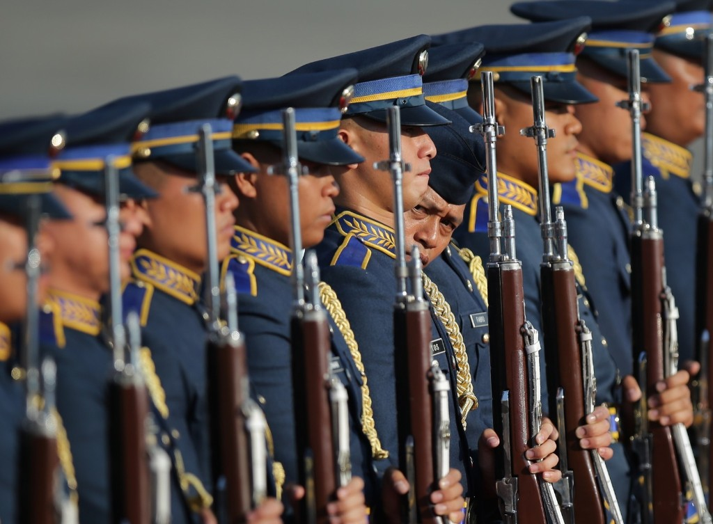 A Filipino trooper inspects the alignment of a guard of honor prior to the arrival of Indonesian President Joko Widodo at the Villamor Air Base in suburban Pasay. AP Photo/Aaron Favila