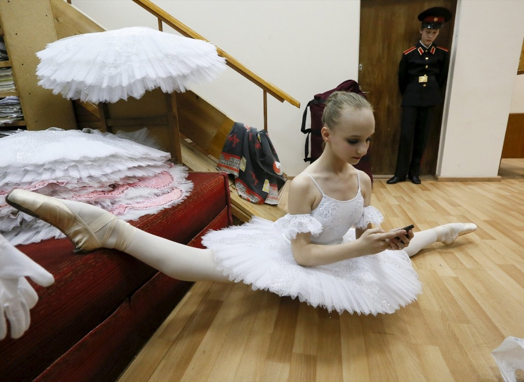 A student of the Krasnoyarsk choreographic college prepares backstage before a dress rehearsal. REUTERS/Ilya Naymushin