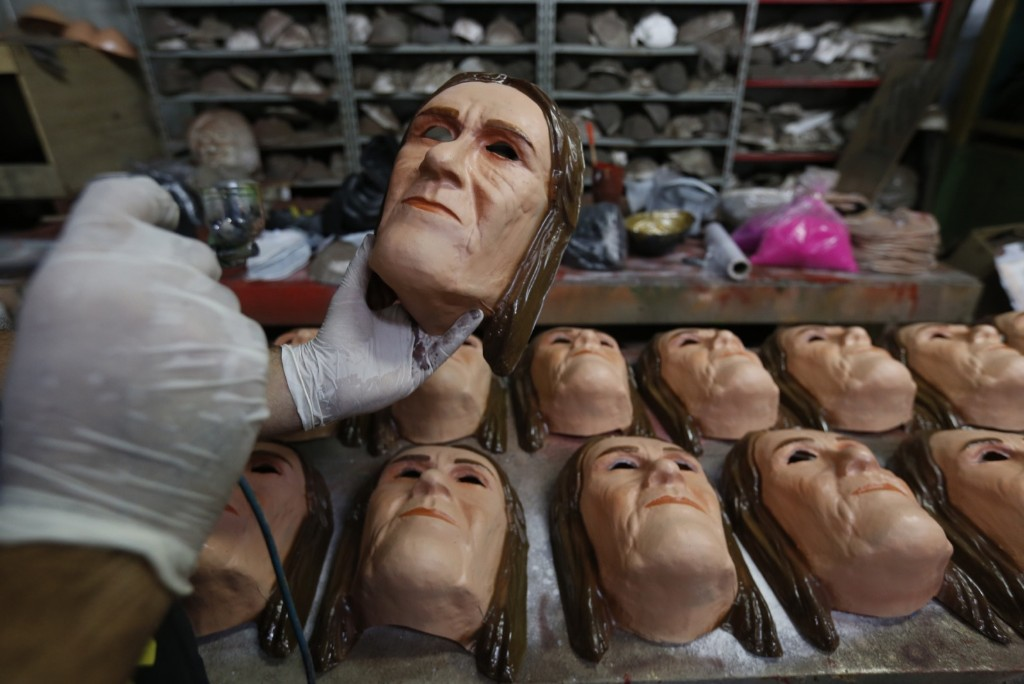 A worker paints a carnival mask in the likeness of Petrobras' former CEO Maria das Gracas Foster at the Condal factory in Rio. AP Photo/Silvia Izquierdo