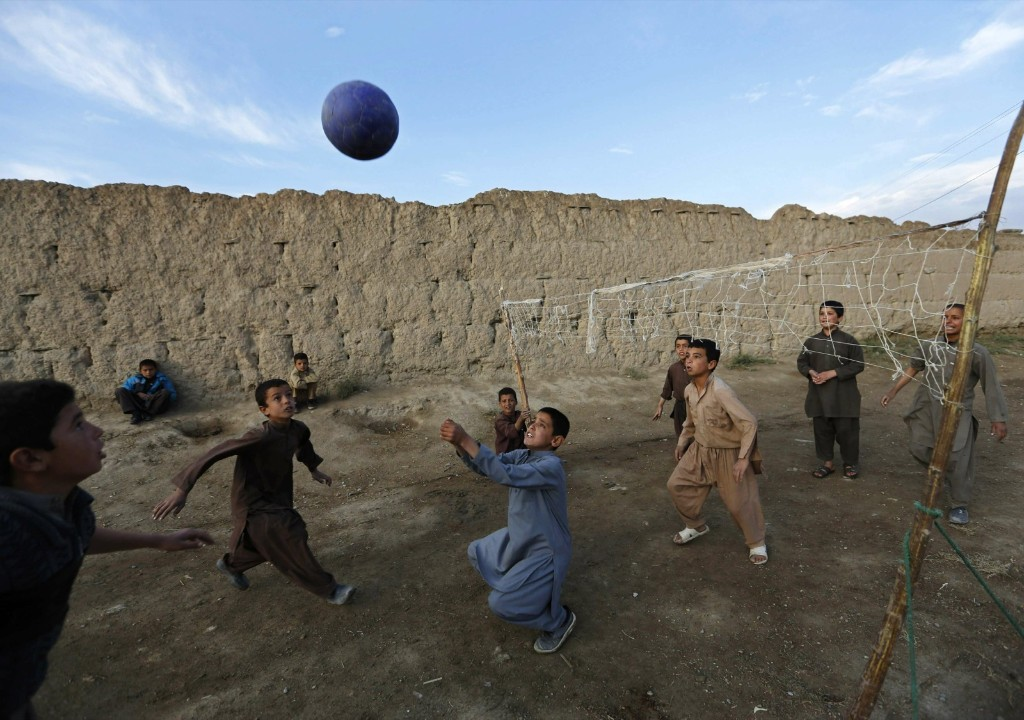 Afghan boys play volleyball on the outskirts of Kabul. REUTERS/Mohammad Ismail