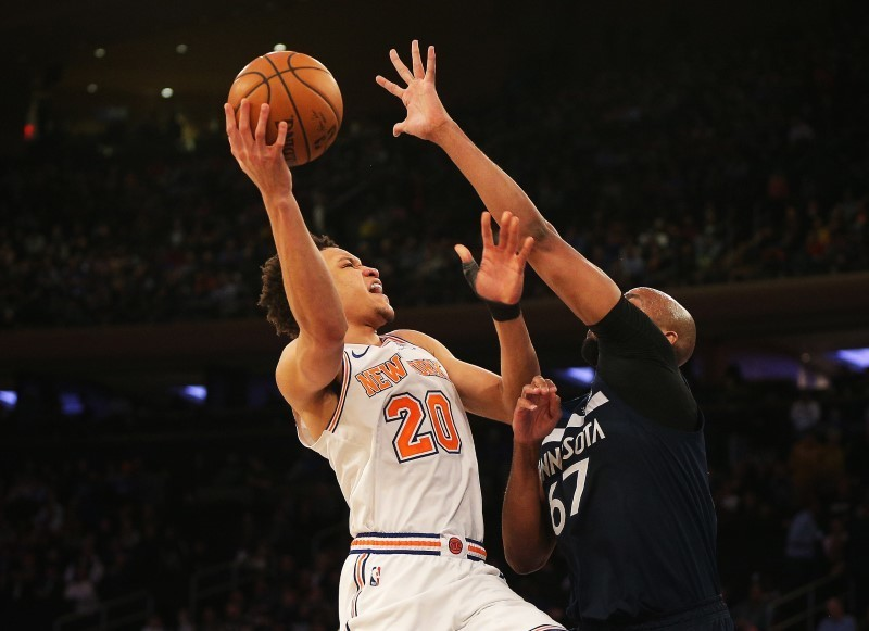 Feb 22, 2019; New York, NY, USA; New York Knicks forward Kevin Knox (20) takes a shot against Minnesota Timberwolves forward Taj Gibson (67) during the second half at Madison Square Garden. Mandatory Credit: Andy Marlin-USA TODAY Sports