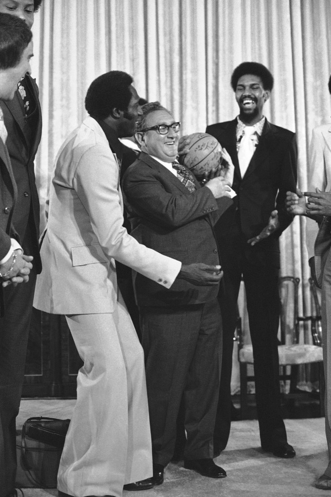 Henry Kissinger loses the handle as he tries to spin the ball on his finger for Meadowlark Lemon in Washington, 1976. AP Photo