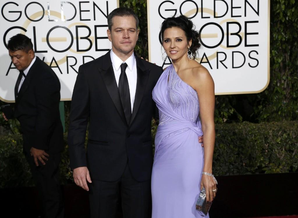 Matt Damon and wife, Luciana Barroso, arrive at the 73rd Golden Globe Awards. REUTERS/Mario Anzuoni