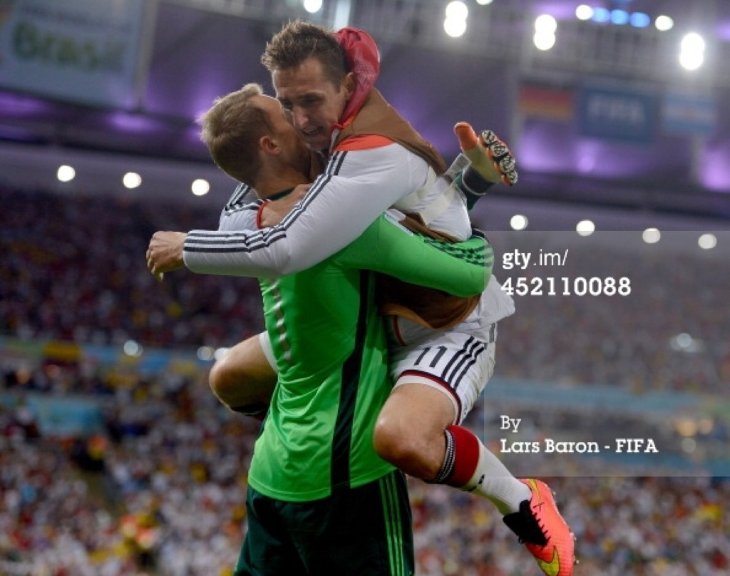 Goalkeeper Manuel Neuer and Miroslav Klose of Germany celebrate their team's goal. Lars Baron/FIFA/Getty Images