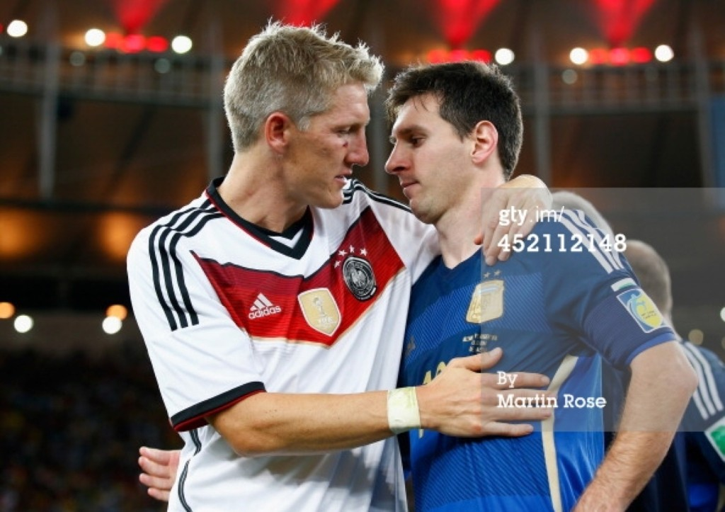 Bastian Schweinsteiger of Germany hugs Lionel Messi of Argentina after Germany's 1-0 victory. Martin Rose/Getty Images