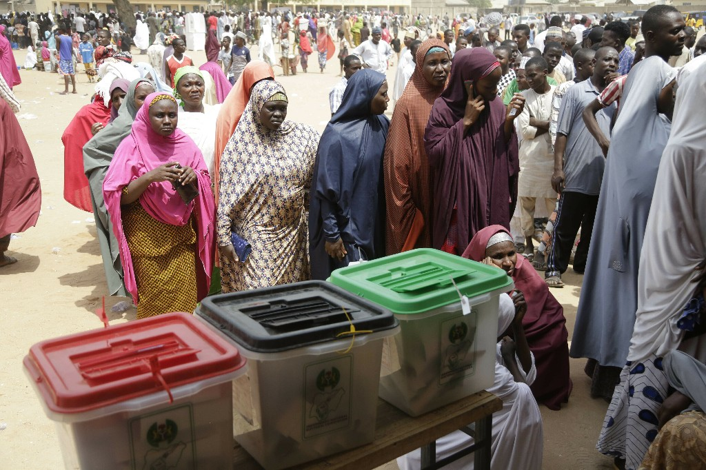 Voters line up to cast their votes during the Presidential and National Assembly election in Damilu Yola, Nigeria, Saturday, Feb. 23, 2019. Africa's most populous country goes to the polls on Saturday to decide whether President Muhammadu Buhari deserves a second term. While more than 70 people are running to lead Nigeria, the close race comes down to Buhari and a billionaire former vice president, Atiku Abubakar. (AP Photo/Sunday Alamba)