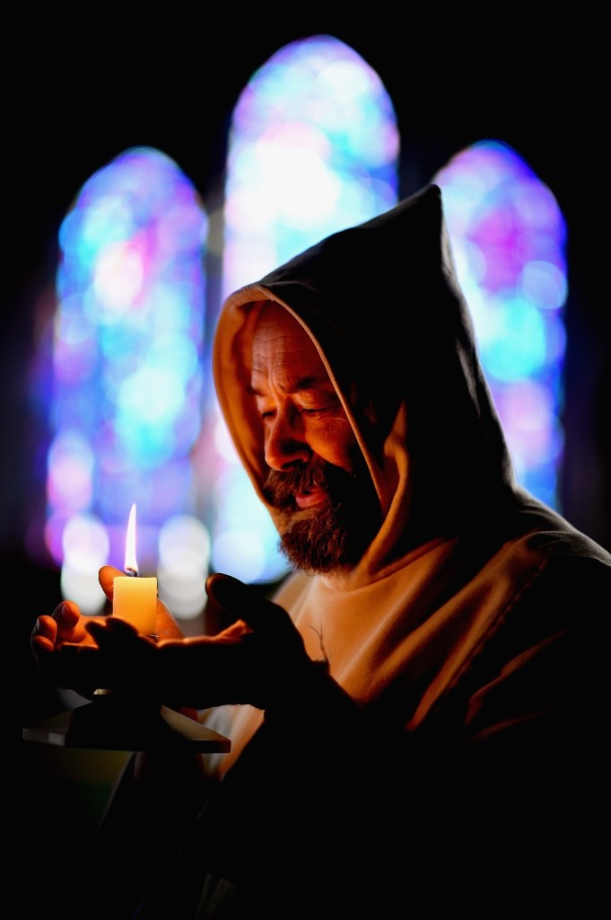 Father Giles Conacher lights a candle at Pluscarden Abbey in Elgin, Scotland. Jeff J Mitchell/Getty Images