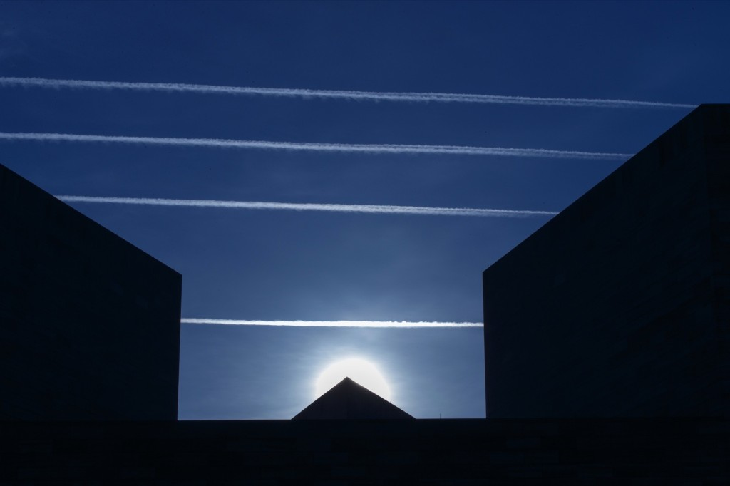 Contrails from jet planes passing overhead intersect the National Museum of Art in DC. AP Photo/J. Scott Applewhite
