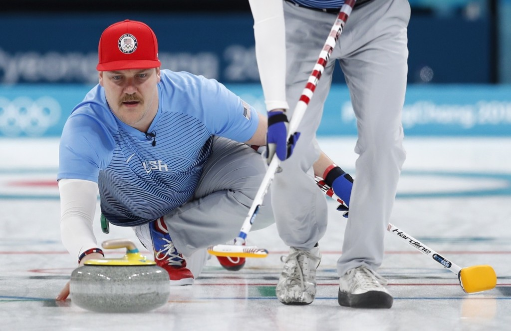 Matt Hamilton of the U.S. delivers the stone during victory over Sweden in gold medal curling match. REUTERS/John Sibley