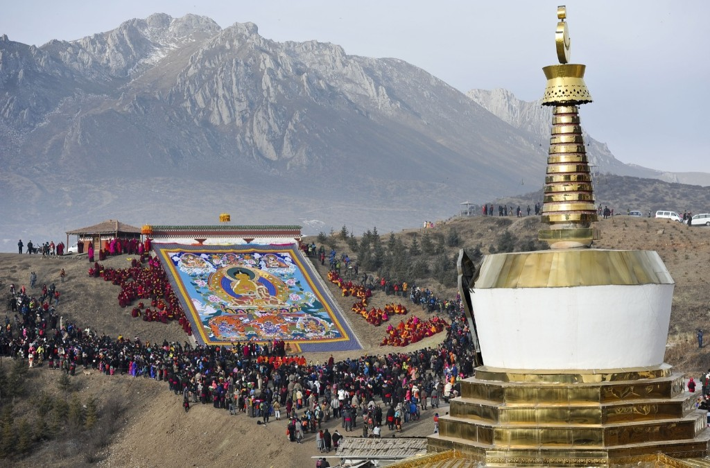 People worship the giant thangka during the Sho Dun Festival in Gannan Tibetan Autonomous Prefecture, Gansu Province of China. ChinaFotoPress via Getty Images