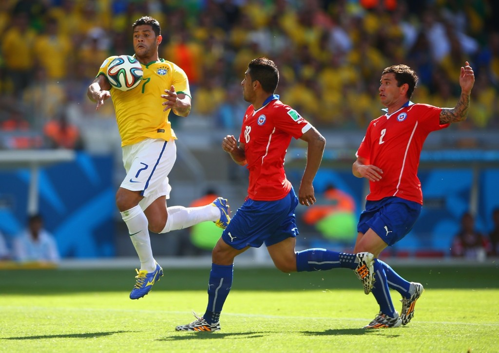 Hulk of Brazil handles the ball before scoring a goal that was disallowed. Paul Gilham/Getty Images