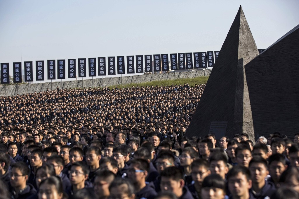 A memorial ceremony at the Nanjing Massacre Museum. REUTERS/Aly Song