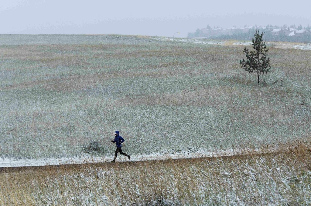 A jogger runs through the snow at Nose Hill Park in Calgary. REUTERS/Todd Korol