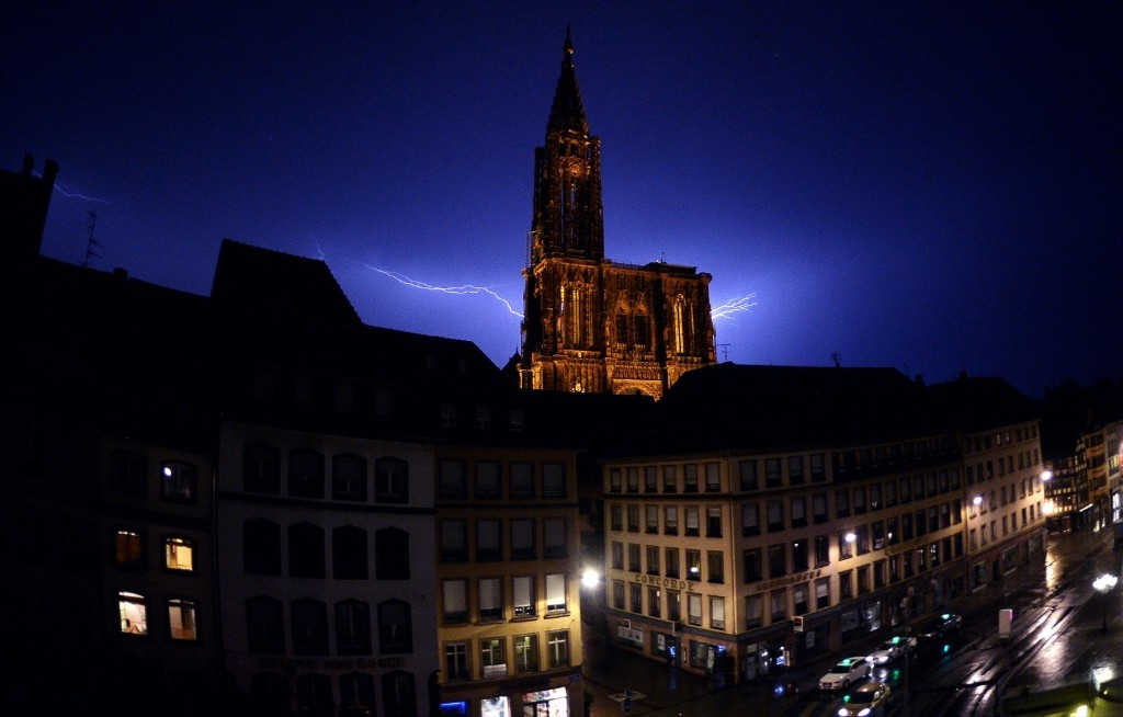Lightning flashing through the sky over the Cathedral in Strasbourg, France. PATRICK HERTZOG/AFP/Getty Images