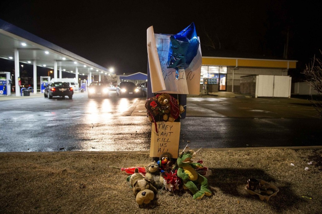 A memorial at the scene where a policeman fatally shot a black man at a suburban St. Louis gas station in Berkeley, Missouri. REUTERS/Aaron P Bernstein