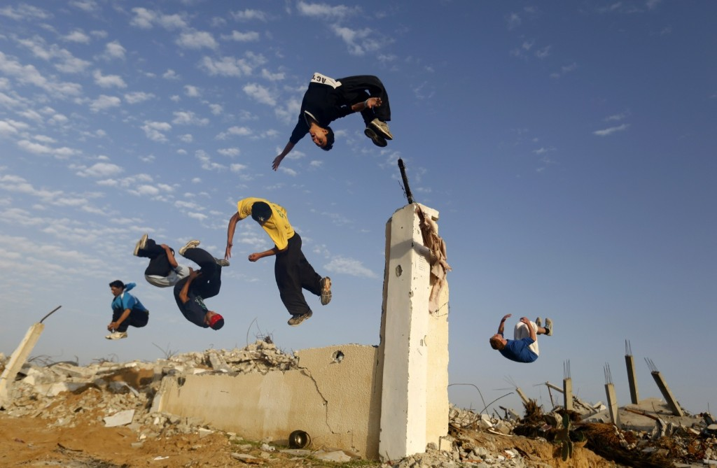 Palestinian youths practice their Parkour skills in the Gaza Strip. MOHAMMED ABED/AFP/Getty Images