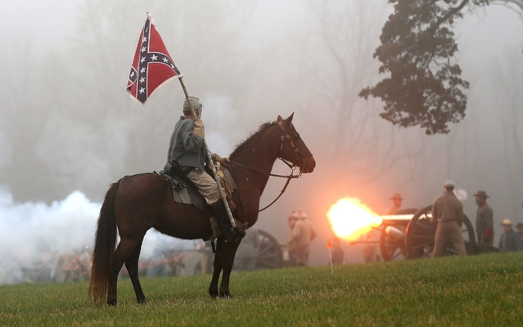 American Civil War re-enactors take part in a re-enactment of the Battle of Appomattox to commemorate the 150th anniversary of General Robert E. Lee's surrender. Win McNamee/Getty Images