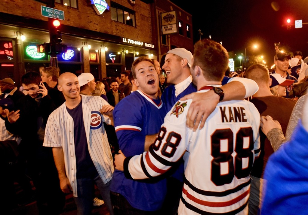 Cub fans celebrate outside Wrigley Field. AP Photo/Matt Marton
